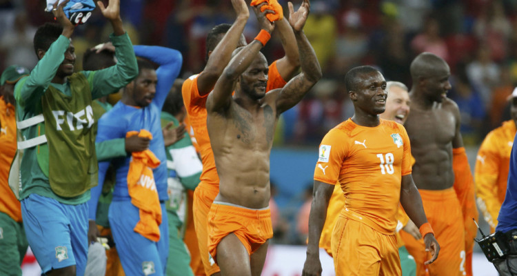 Ivory Coast's players celebrate after their 2014 World Cup Group C soccer match against Japan at the Pernambuco arena in Recife